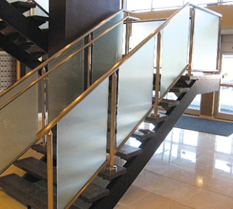 Polished stainless steel and glass panel handrail