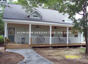 Porch addition and scored concrete on 2' diamond pattern